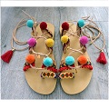 Leather sandals customized with ribbon and pompons